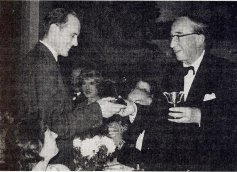 David Millett (on the left) receives a gliding trophy in 1959