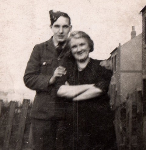 1fe0ea0791 R J Mitchell with his mother taken in Seaham at the time of his enlistment  into the RAF in December 1939.